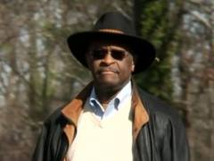 Herman Cain wearing a hat